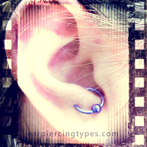 Anti-Tragus ear piercing With Blue Ball Closure Ring