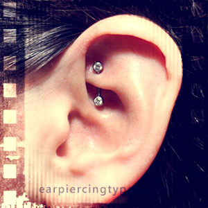 curved barbell rook ear piercing