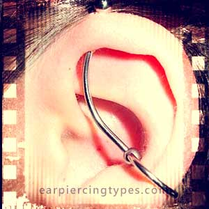 Curved industrial ear piercing