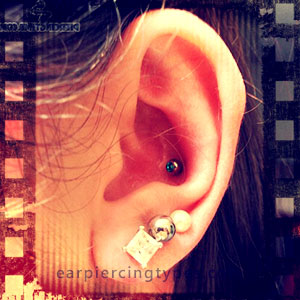 Conch Piercing With Black Labret Stud