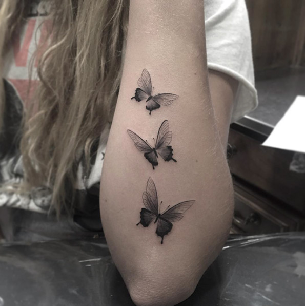 Butterfly Arm tattoo ideas for women 4